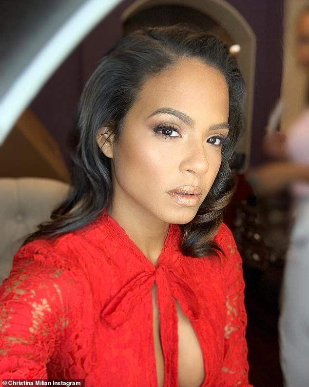 Breathtaking: Christina shared a breathtaking selfie from the bash referring to the bow on her dress, writing, 'The best gifts come with a red bow on top'