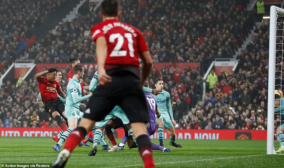 Herrera (centre) watches on as Anthony Martial (left) smashes his low cross in the net to bring United level