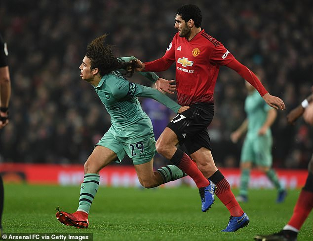 Marouane Fellaini could be seen tugging back Matteo Guendouzi by his hair on Wednesday