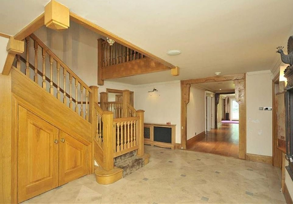 Making an entrance: The elegant hall way includes a grand wooden staircase and period features