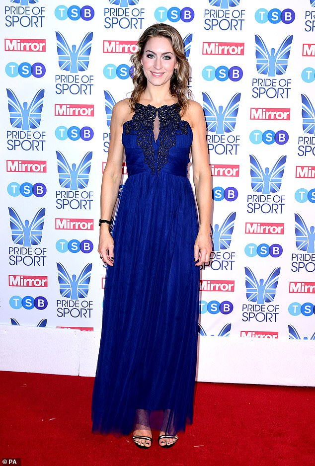 The Olympic gold medal for the skeleton Amy Williams has her picture taken at the awards