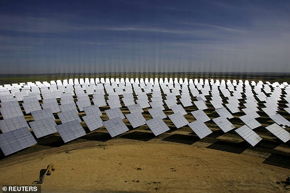 The new storage system stems from researcher into concentrated solar power, which uses vast fields of huge mirrors to concentrate sunlight onto a central tower, where the light is converted into heat that is eventually turned into electricity. Pictured, a solar park at Sanlucar La Mayor, near Seville
