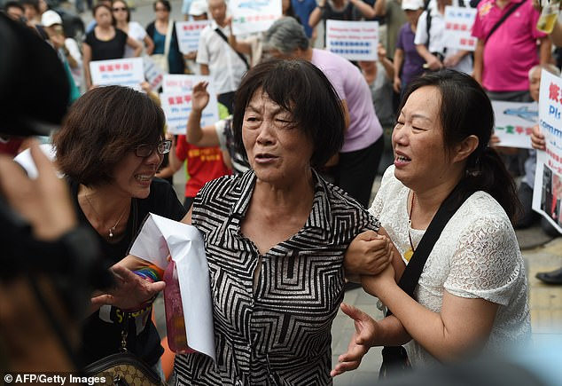 'Handshake' calls to an Inmarsat satellite above the Indian Ocean reveal the Boeing aircraft was still in the air. Pictured: Relatives of passengers on missing Malaysia Airlines MH370 cry in front of media outside the Malaysian embassy in Beijing