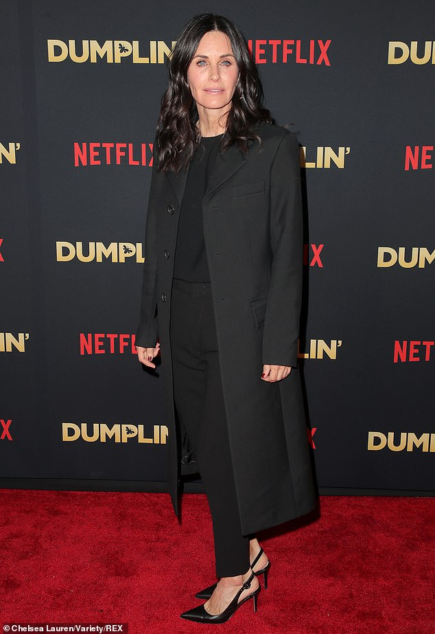 Jennifer's old Friends castmate Courteney Cox was there to support, looking sharp in a black trench, with cigarette pants, a dark sweater, and slingback heels