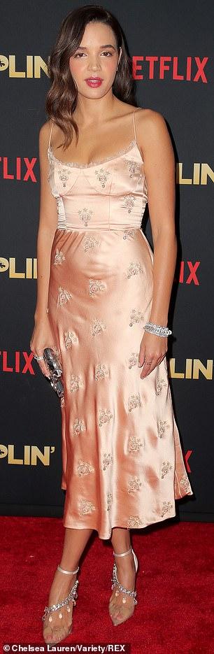 Peachy keen: Dumplin' co-star Georgie Flores rocked silky peach