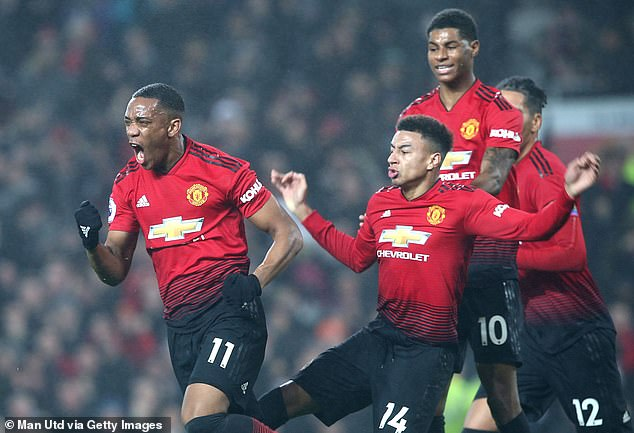 Anthony Martial (left) celebrates after finding the back of the net against Unai Emery's men