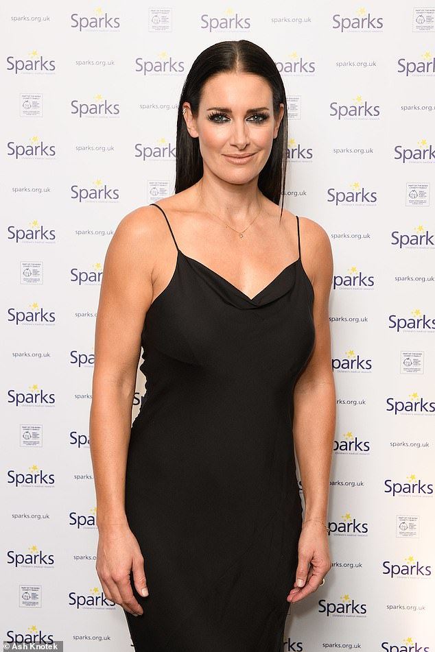 Demure: Kirsty, 42, stunned in a demure black gown and styled her brunette locks in a sleek look