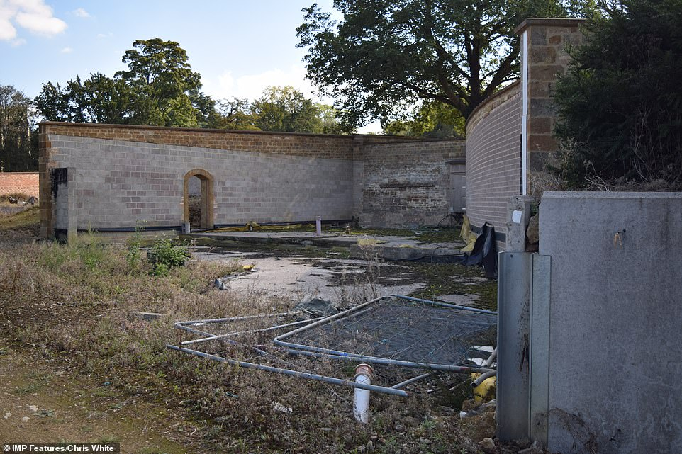 Pictures of the site show the many years of building work and renovations lying exposed to the elements