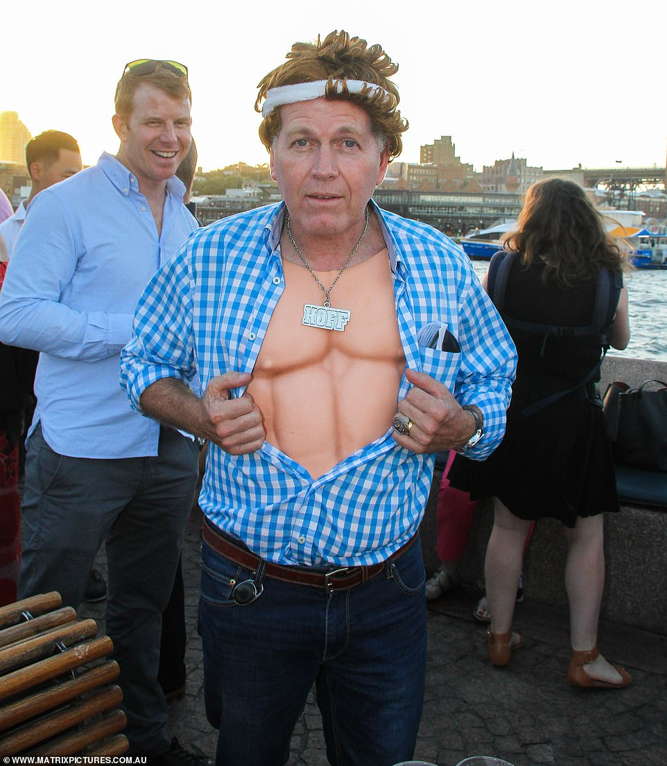 One man wore a wig and white sweat headband along with silicone washboard abs and silver necklace engraved with 'HOFF'