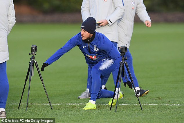 Chelsea star Eden Hazard tests his reaction time during training at Cobham