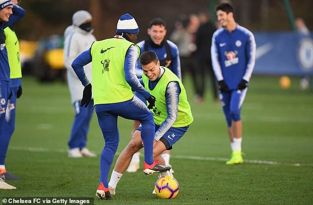 Cesar Azpilicueta looks at the intense training session