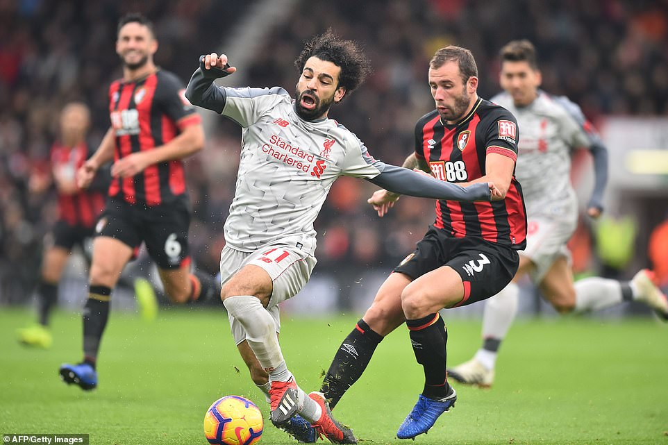 Mohamed Salah is tripped by Bournemouth's Steve Cook but stays on his feet before slotting in Liverpool's second goal