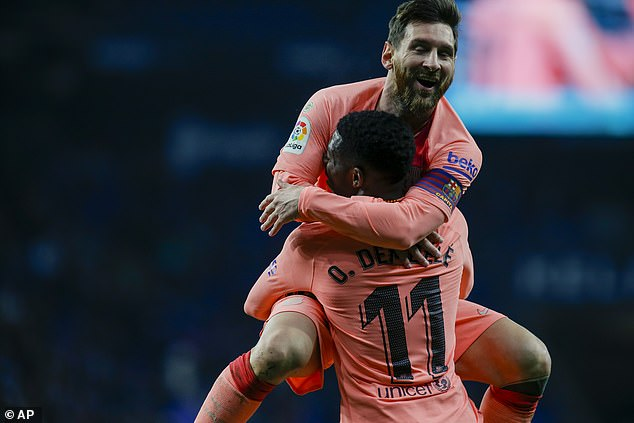 Messi celebrates with Ousmane Dembele after the forward had doubled their advantage