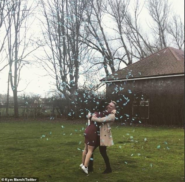 Exciting:The Corrie star posted a snap on Twitter of the aspiring singer, 21, hugging her partner over the exciting news, with blue party confetti to ring in the celebration