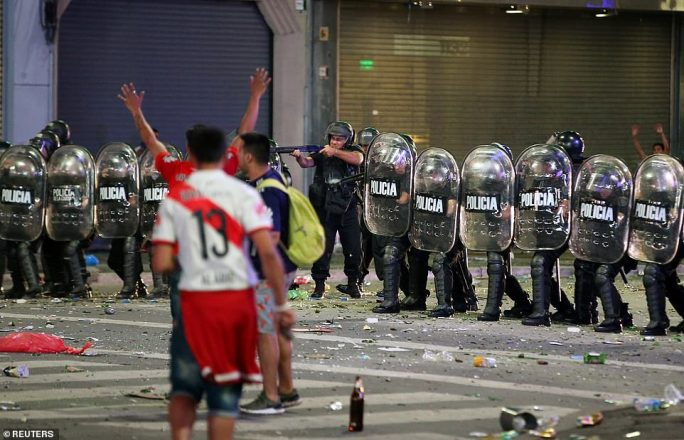 River Plate supporters clashed with riot police in the Argentine capital Buenos Aires as celebrations to mark their Copa Libertadores win over bitter rivals Boca Juniors got out of hand later in the evening