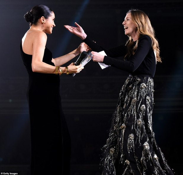 Reunited: Meghan honoured her bridal gown designer during the ceremony, while Waight Keller  thanked the royal personally in her speech at the star-studded awards ceremony at the historic venue in Kensington, London