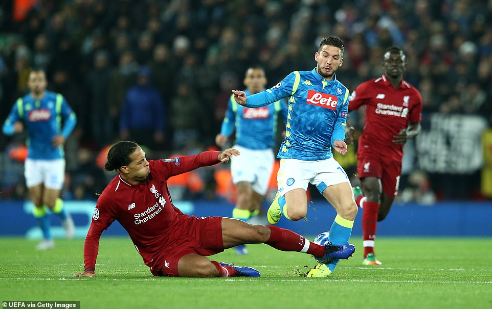 Virgil van Dijk was cautioned after this tackle on Dries Mertens caught the ankle with his follow through