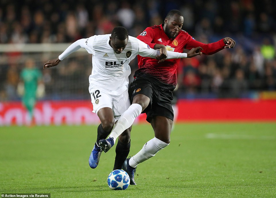 Lukaku (right) battles withValencia's Mouctar Diakhaby (left) for possession during the first half at the Mestalla Stadium