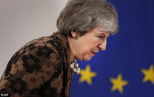 The survey also found thatmore than half of voters, 53 per cent, disapprove of the way the PM has handled Brexit, compared to 28 per cent who approve. She is pictured here arriving fora media conference at an EU summit in Brussels on Friday