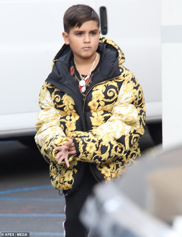Post-birthday look:Disick was also wearing a red, brown and black patterned shirt along with some black jogging pants with white stripes and red, white and black sneakers