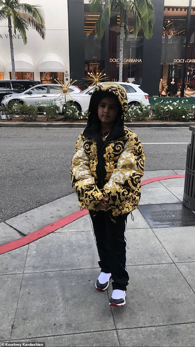 New coat: Mason's mother Kourtney also shared a new snap of her son wearing his new gift from Kris on her Instagram story