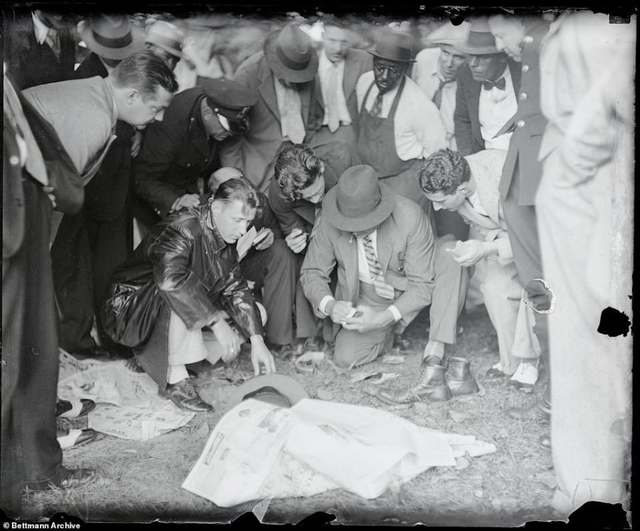 No CSI:  Crowds are permitted to gather round detectives in this shot from Washington D.C. where Long Island man Thomas N.Innes was found bound and gagged at the bottom of the tidal basin. Investigating officers sift through his belongings without gloves as curious spectators peer over them