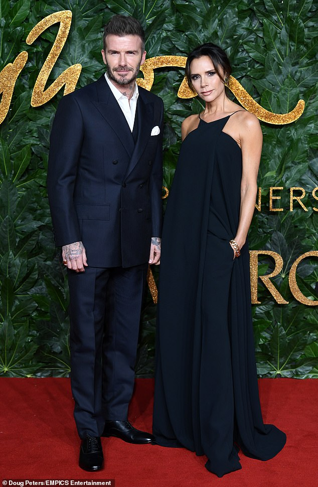 Staying mum: Representatives for David, pictured with his wife Victoria Beckham, recently refused to comment on rumours that the star has had surgical help with his hair