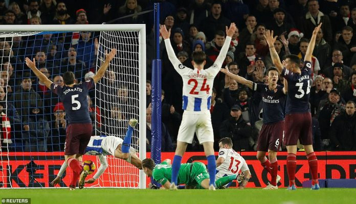 Both sides were left appealing - Brighton for the goal, Arsenal for the foul - as referee Anthony Taylor had to make the decision