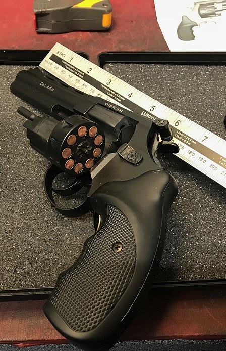 he was found with a stash of drugs and this pistol, originally from Czech Republic