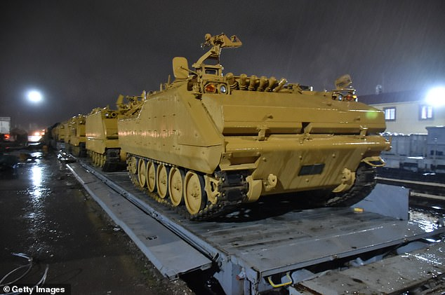 Russia has told Turkey to let the Syrian government take back areas vacated by US troops with Ankara preparing to clear Kurdish fighters from a town in the war-torn country.Pictures have emerged today showing Turkish armoured military vehicles (pictured) and troop carriers being dispatched to the border with Syria today