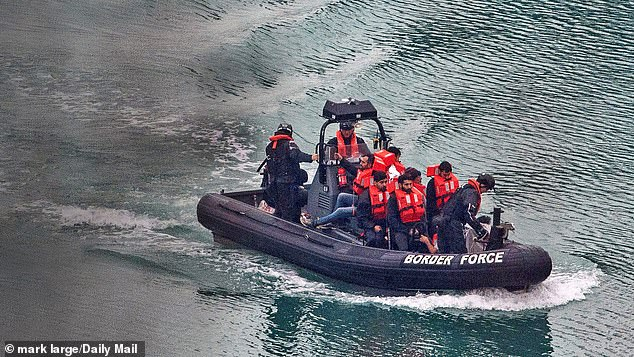 ight migrants brought ashore at Dover Harbour by the UK Border Force officials