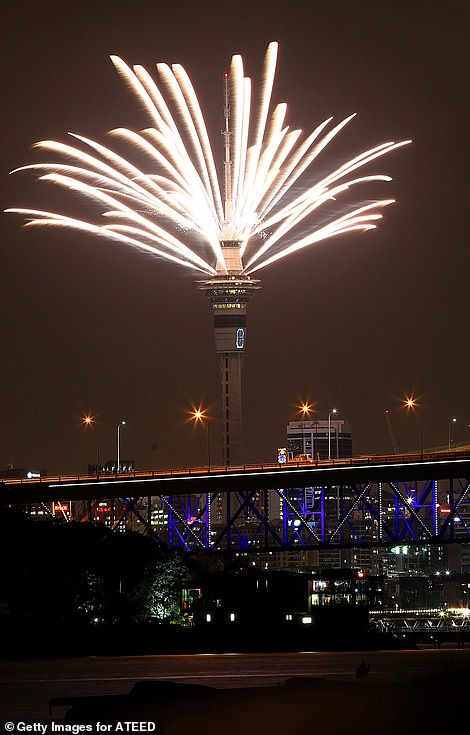 Fireworks explode from the Sky Tower during Auckland's New Year's Eve celebrations