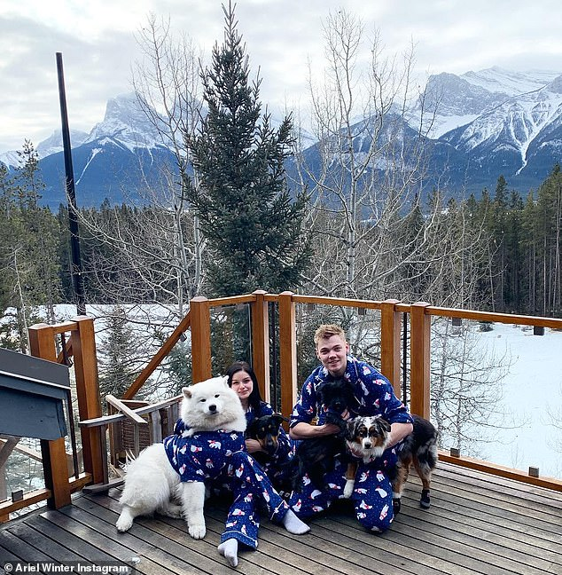 White Christmas: Ariel spent the holiday with her boyfriend and pups in the snowy mountains and the whole group donned matching pajamas