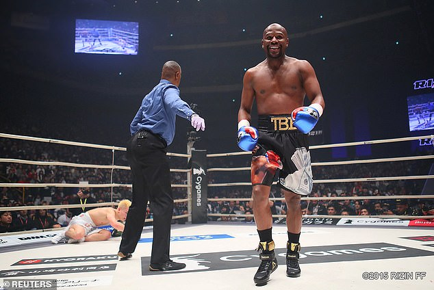 Mayweather enjoyed himself outside Tokyo, smiling for much of the first few minutes