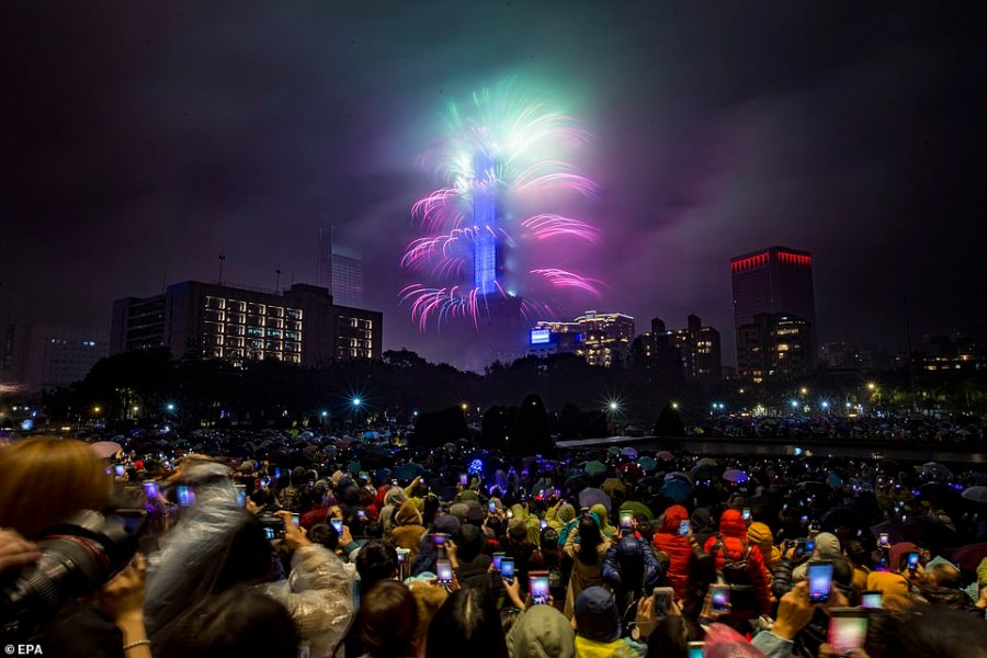Fireworks and lights were seen illuminating the night sky at Taipie 101 skyscraper in Taiwan as spectators welcomed in the New Year