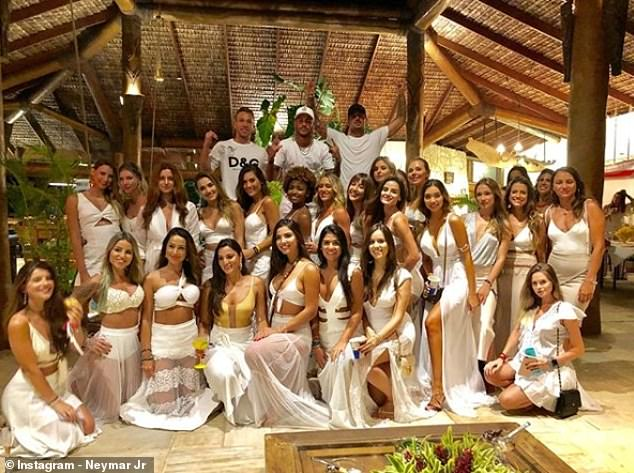 Neymar (back, middle) posing on a white New Years Eve party as he relaxes at home in Brazil