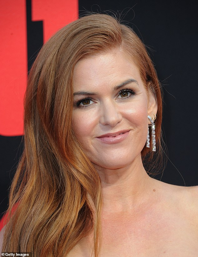 Signature: The former Australian soap star is known for her red hair, with her only colouring it a handful of times including for the role of Mary Jane in Scooby Doo in 2002