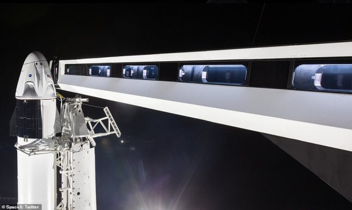 'Preparing to return human spaceflight capabilities to the United States, Crew Dragon and Falcon 9 went vertical at historic Launch Complex 39A in Florida,' SpaceX tweeted, revealed the rocket is now upright on the launch pad.