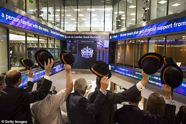 University of Leicester researchers interviewed 58 members of workplace choirs to see if group singing could relieve stress (pictured:Singers from office choirs after opening the London Stock Exchange with a song in 2014)