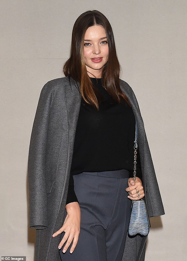 Glowing:Miranda carried a blue leather Louis Vuitton satchel bag, and opted for natural hair and make-up to accentuate her striking features