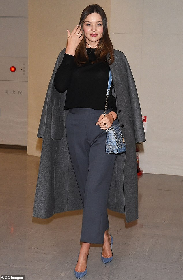 Elegant: Miranda Kerr looked every inch the chic traveller as she made a very stylish arrival at Narita International Airport in Tokyo, Japan, on Wednesday