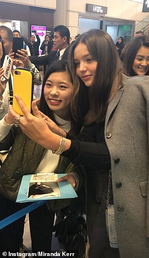 What a welcome! The former Victoria's Secret Angel stopped to pose for selfies with her army of fans and signed plenty of autographs before making her way through the terminal