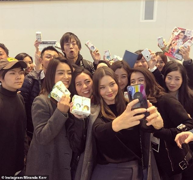 Good to be back:The mother-of-two seemed delighted to be back in Japan, posting a series of Instagram stories of her arriving to a sea of thrilled fans posing with Kora Organics products