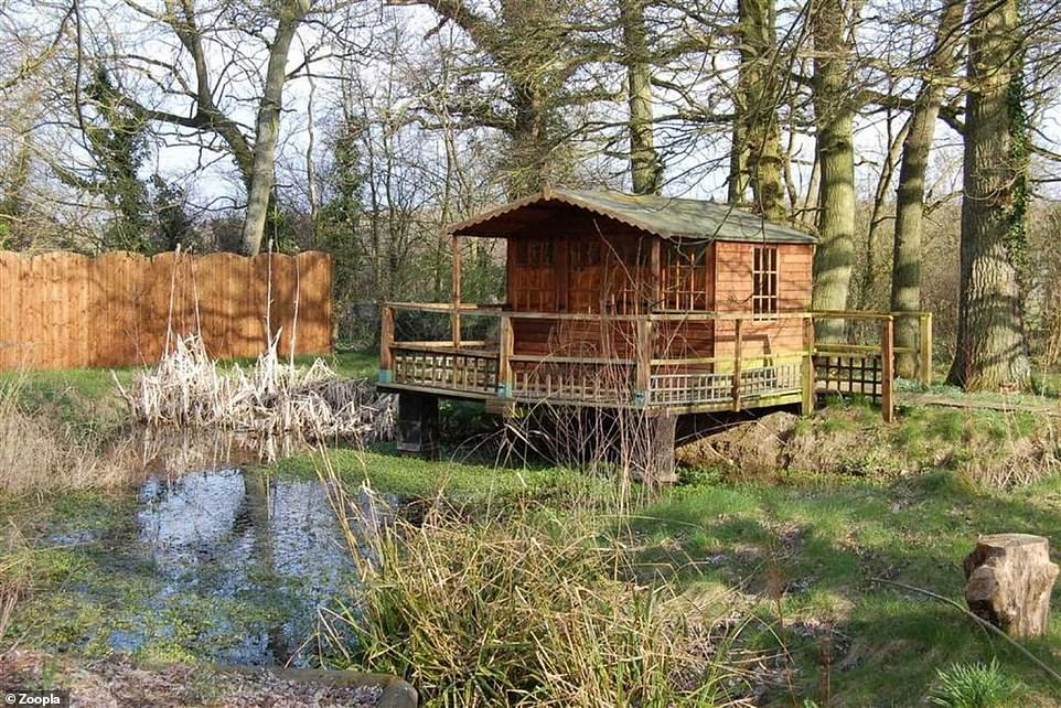 The property comes with two acres of land and a summer house that overlooks a duck pond
