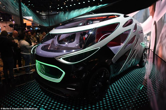 Major companies including BMW, Honda and Mercedes had concepts to show off at CES, many complete with facial recognition and  OLED touchscreens. Pictured is Mercedes' concept car, which can be used for personal rides and delivery