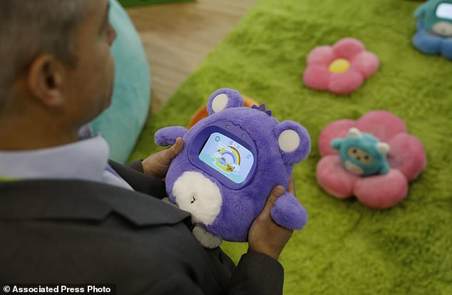Its creators say that Woobo does not paste children on the screen because he invites them to find things at home, help parents cook dinner or play family games like charades. A man holds a Woobo talking robot at the Woobo booth at CES International on Wednesday, January 9th