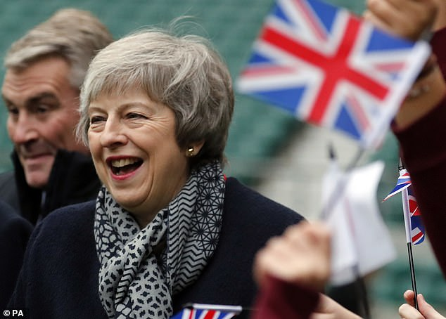 The PM (pictured at Twickenham yesterday) has been making increasingly desperate efforts to turn the tide of opinion on her plan - including reaching out to Labour MPs and union leaders