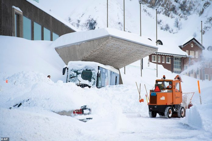 Snow is piled up outside the Hotel Saentis in Switzerland after an avalanche. Police said three people were slightly hurt but emergency crews have been conducting searches in the area