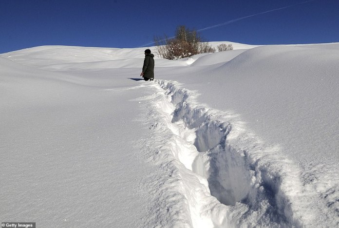 A villager walking through deep snow in the Disbudak village of Bingol province located in Eastern Anatolia Region, Turkey today