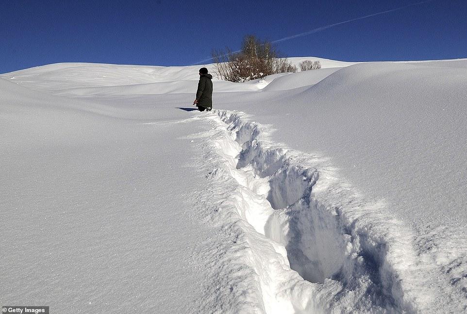A villager walking through deep snow in the Disbudak village of Bingol province located in Eastern Anatolia Region, Turkey today